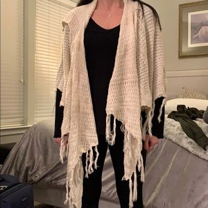 Poof! Hooded poncho